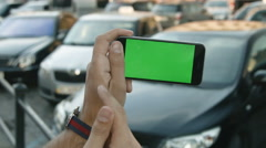 Close Up Man Holding Smartphone Touch Screen With Green Screen Chroma Key For Stock Footage