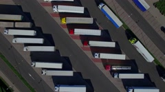Fly over lorry trucks rows at parking place spot lot aerial top view above 4K Stock Footage
