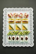 An elegantly arranged platter of canapés Stock Photos