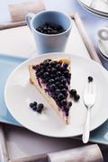 A slice of blueberry cheesecake Stock Photos