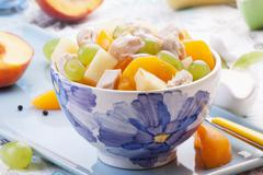 Chicken salad with grapes, peaches and pineapple Stock Photos