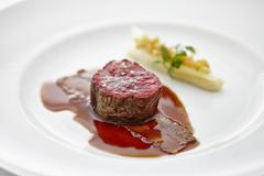 Beef medallion with bacon and asparagus Stock Photos