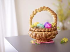 A Easter basket made of bread filled with Easter eggs Stock Photos