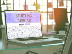 Laptop Screen with Studying Abroad Concept. 3D Illustration Stock Illustration