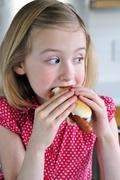 A little girl eating a hot dog Stock Photos