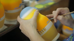 Painting of a nesting doll with paint and brushes Stock Footage