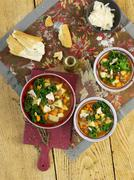 Vegetable soup with borlotti beans and green kale Stock Photos