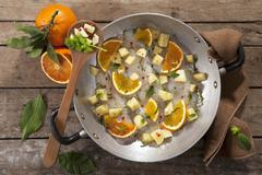 Platessa all'arancia (raw plaice fillet with potatoes, orange and peppermint, Stock Photos
