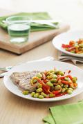 Tuna steak with a bean and pepper medley Stock Photos