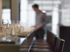 A row of chairs at a restaurant table Stock Photos