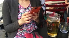 Girl Text Message On Smart Phone In a Bar, Zoom Out Stock Footage