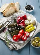 An appetiser platter with stuffed vine leaves and vegetables Stock Photos