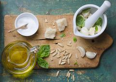 Ingredients for basil pesto on a chopping board Stock Photos