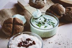 Bread rolls with various spreads Stock Photos