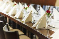 A table laid for a wedding reception in a restaurant Stock Photos