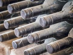 Bottles of wine stored in a cellar in the Kakheti wine region, Georgia, Caucasus Stock Photos