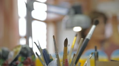 Brushes on an artist's table Stock Footage
