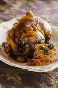 Chicken á l'orange with a fruity sauce and potato straw Stock Photos