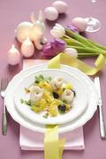 Steamed zander rolls with potatoes, olives and pine nuts for Easter Stock Photos