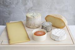 Various Cheese on Wooden Breadboards Stock Photos