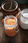 An arrangement of red lentils and wholemeal flour Stock Photos