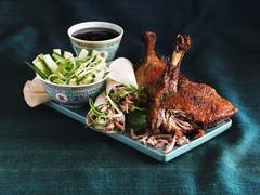 Crispy Peking duck and duck wraps with a cucumber salad and a soy sauce dip Stock Photos