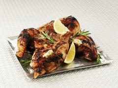 Lemon chicken with rosemary on a sliver platter Stock Photos