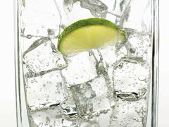 Mineral water with ice cubes and a slice of lime Stock Photos