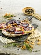 Tarte flambée with beetroot and walnuts Stock Photos