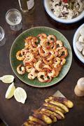 Spicy prawns with rice, beans and fried plantains Stock Photos