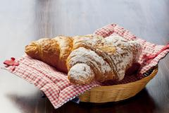 Chocolate and cinnamon croissants in a bread basket Stock Photos