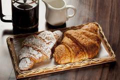 Chocolate and cinnamon croissants and black coffee Stock Photos
