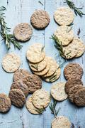 Crackers, oat cakes and rosemary Stock Photos