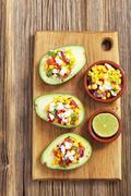 Stuffed avocados with corn salsa Stock Photos