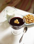 Blueberry soup with almond biscuits and a jug of milk for an autumnal breakfast Stock Photos