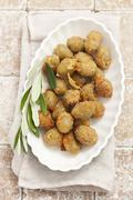 Breaded fried olives filled with anchovies Stock Photos