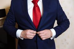 Businessman hands with cufflinks and clocks. Elegant gentleman clother Stock Photos