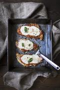 Breaded chicken breast topped with tomato sauce and mozzarella Stock Photos