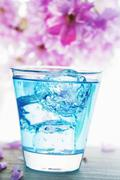 Blue Curacao drink with ice cubes Stock Photos