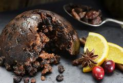 Christmas pudding with cranberries and oranges Stock Photos