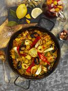 Paella with seafood and artichokes Stock Photos