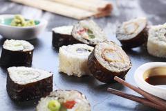 Various maki sushi with soy sauce and wasabi Stock Photos