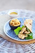 A chicken wrap with hummus Stock Photos