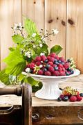 An arrangement of raspberries and blueberries in a bowl Stock Photos