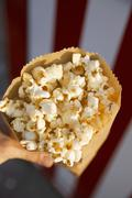 A paper bag full of popcorn Stock Photos