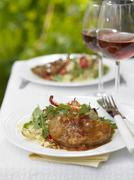 Tuna steak with gravy, couscous and rocket Stock Photos