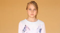 Young beautiful teenage girl hears the good news. Stock Footage