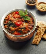 A casserole made with beans, peppers and spinach Stock Photos