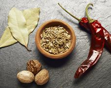 Fennel seeds, bay leaves, nutmeg and dried chilli peppers Stock Photos