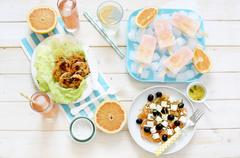 A summer buffet featuring grapefruit dishes and drinks Stock Photos